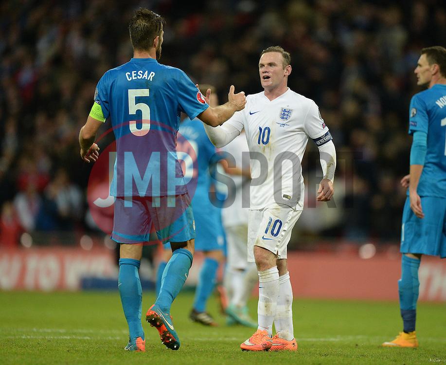 Wayne Rooney of England (Manchester United) embraces Bostjan Cesar of Slovenia  - Photo mandatory by-line: Alex James/JMP - Mobile: 07966 386802 - 15/11/2014 - SPORT - Football - London - Wembley - England v Slovenia - EURO 2016 Qualifier