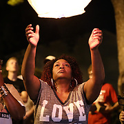 Vivian Carr, mother of Justin Carr, lets go of a paper lantern in memory of her son. Nearly a year to the day her son was shot and killed during one of two violent nights of protesting in Charlotte over the CMPD killing of Keith Lamont Scott.
