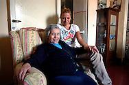 Roma  24 Maggio 2007.Anziana assistita  da volontaria della  Caritas   Diocesana di Roma ..Elderly assisted by volunteers from Caritas of Rome