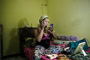 Ririn Agustine applies make up in her room before heading to perfomance arena in Mojokerto, East Java, Indonesia, June 9, 2015.