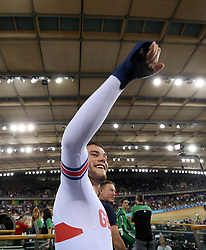 Matthew Walls of Great Britain celebrates after winning the Men's Omnium Points Race 4/4 during day three of the Tissot UCI Track Cycling World Cup at Lee Valley VeloPark, London.