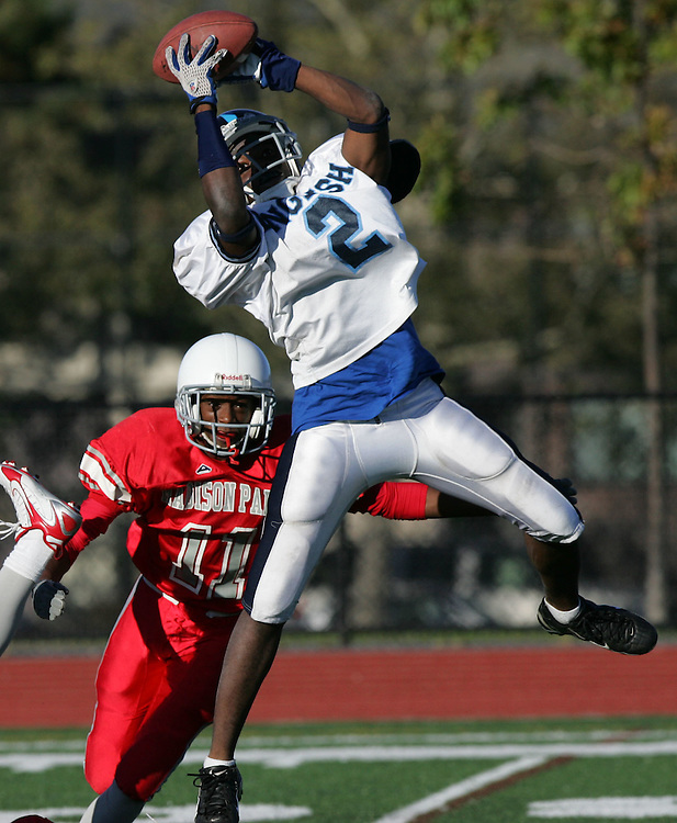(Boston, MA - October 10, 2008) - Cedric Miles of Boston English leaps up to grab a pass in the second quarter of their game against Madison Park High School. Madison Park led 14-0 at halftime on two rushing touchdowns..  .Herald photo by Will Nunnally