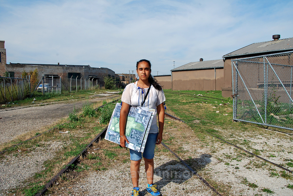 USA, Chicago, August 25, 2009.  Carolina Macias, 16, holding park proposals near the long-abandoned industrial buildings near the east side of the Celotex clean-up site. The Little Village Environmental Justice Organization, headquartered in a predominantly Mexican-American neighborhood of Chicago, campaigns not only against pollution but for clean power, park facilities, urban agriculture, and restoring public transit. LVEJO's staff and volunteers make significant outreach and education efforts, especially for youth. Photo for an HOY feature story by Jay Dunn.