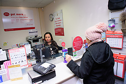 Pictured is subpostmistress Angelina Singadia serving a customer<br /> <br /> Gill Furniss, MP for Brightside and Hillsborough, visited Margetson Crescent Post Office, Sheffield to meet subpostmistress Angelina Singadia and her team.<br /> <br /> Date: December 8, 2017