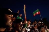 Imran Khan, chairman of the Pakistan Tehreek-e-Insaf political party waves a cricket bat, the party's election symbol, while speaking to supporters from the stage during an election campaign rally in Faisalabad, Pakistan, Sunday, May 5, 2013. Pakistan is scheduled to hold parliamentary elections on May 11, the first transition between democratically elected governments in a country that has experienced three military coups and constant political instability since its creation in 1947.