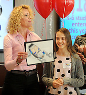Laura Thompson Barnes (L) introduces Sophia Ponomarenko, who's drawing of The Maserati Leaper won 1st place and the grand prize in the Thompson Organization's Draw the Future Contest Thursday April 16, 2015 at Thompson Toyota in Doylestown, Pennsylvania. A record 1,184 entries from kindergarten to sixth grade were received from students at more than 40 local schools. The grand prize winner will have her drawing featured on a billboard. (Photo by William Thomas Cain/Cain Images)