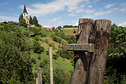 A walking marker points to a local place near Saint Michael's church, on 23rd June 2018, in Celje, Slovenia.