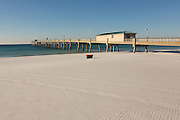 Okaloosa Island Pier along an empty beach in Fort Walton Beach, Florida.