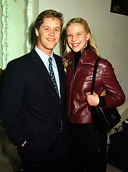 MR PETER THOMPSON and MISS SOPHIA BURRELL, at a party in London on 13th October 1999.MXO 24