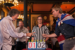 © licensed to London News Pictures. London, UK 08/08/2012. James May's Man Lab team competing against Great Britain team at the UK Rock Paper Scissors Championship at The Knights Templar Pub in central London. Over 100 contestants take part in unique decision making competition. Photo credit: Tolga Akmen/LNP