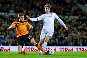 Leeds United forward Patrick Bamford (9) stopped by Hull City defender Callum Elder (26)  during the EFL Sky Bet Championship match between Leeds United and Hull City at Elland Road, Leeds, England on 10 December 2019.