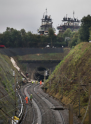 © Licensed to London News Pictures. 16/09/2016. Watford, UK. A landslide can be seen at the entrance to a tunnel where a train has derailed just below an outdoor set from the Warner Brothers studios where the Harry Potter films were made near Watford.. Photo credit: Peter Macdiarmid/LNP