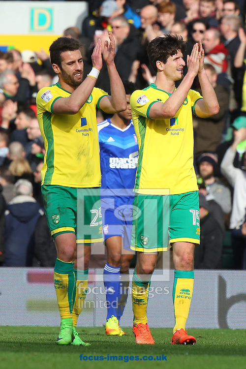 Ivo Pinto of Norwich and Timm Klose of Norwich applaud the fans at the end of the Sky Bet Championship match at Carrow Road, Norwich<br /> Picture by Paul Chesterton/Focus Images Ltd +44 7904 640267<br /> 26/02/2017