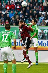15.10.2011,Volkswagen Arena, Wolfsburg, GER, 1.FBL,VfL Wolfsburg vs 1. FC Nuernberg , im Bild Kopfballduell zwischen Tomas Pekhart (Nuernberg #9) und  Hasan Salihamidzic (Wolfsburg #11) .// during the match from GER, 1.FBL, VfL Wolfsburg vs 1. FC Nuernberg  on 2011/10/15, Volkswagen Arena, Wolfsburg, Germany..EXPA Pictures © 2011, PhotoCredit: EXPA/ nph/  Schrader       ****** out of GER / CRO  / BEL ******