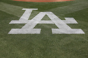 LOS ANGELES, CA - APRIL 28:  The Los Angeles Dodgers logo is painted on the grass for the game against the Milwaukee Brewers on Sunday, April 28, 2013 at Dodger Stadium in Los Angeles, California. The Dodgers won the game 2-0. (Photo by Paul Spinelli/MLB Photos via Getty Images)
