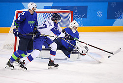 GANGNEUNG, SOUTH KOREA - FEBRUARY 17: Matej Paulovic of Slovakia vs Blaz Gregorc of Slovenia and Gasper Kroselj of Slovenia during the ice hockey match between Slovenia and Slovakia in  the Preliminary Round on day eight of the PyeongChang 2018 Winter Olympic Games at Kwangdong Hockey Centre on February 17, 2018 in Gangneung, South Korea. Photo by Kim Jong-man / Sportida