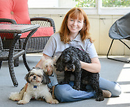 Tess Ross of The Pet Nanny & Dog Walker poses with her dogs August 18, 2015 in Levittown, Pennsylvania. (Photo by William Thomas Cain)
