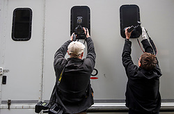 © Licensed to London News Pictures. 07/06/2018. London, UK. Photographers attempt to photograph through the window of a police van, believed to be carrying Jamie Acourt, as it arrives at Westminster Magistrates Court in London where he  is charged with conspiracy to supply cannabis. the former suspect in Stephen Lawrence's murder in 1993, was arrested in Barcelona in May and arrived in the UK on Wednesday. Photo credit: Ben Cawthra/LNP