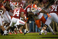 #94 Carlos Watkins of Clemson, converges on Alabama running back #34 Damien Harris.