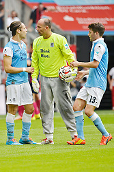 10.08.2014, Allianz Arena, Muenchen, GER, 2. FBL, TSV 1860 Muenchen vs RasenBallsport Leipzig, 2. Runde, im Bild Gary Kagelmacher (TSV 1860 Muenchen), Gabor Kiraly, Torwart (TSV 1860 Muenchen), Ilie Sanchez (TSV 1860 Muenchen), v. li. // during the German second Bundesliga 2nd round match between TSV 1860 Munich and RasenBallsport Leipzig at the Allianz Arena in Muenchen, Germany on 2014/08/10. EXPA Pictures &copy; 2014, PhotoCredit: EXPA/ Eibner-Pressefoto/ Buthmann<br /> <br /> *****ATTENTION - OUT of GER*****