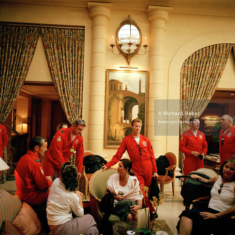 Pilots of the Red Arrows, Britain's RAF aerobatic team gather in hotel after their Bastille Day flypast over Paris.