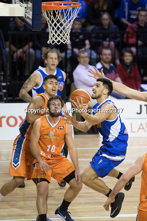 Saints' Shea Ili (R jumps to shoot with Sharks' Mitch Norton during the NBL Wellington Saints vs Southland Sharks basketball match at the TSB Arena in Wellington on Friday the 19th of March 2017. Photo by Marty Melville / www.Photosport.nz