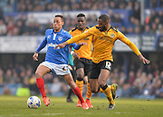 Portsmouth midfielder Kyle Bennett and Newport County defender Janoi Donacien during the Sky Bet League 2 match between Portsmouth and Newport County at Fratton Park, Portsmouth, England on 12 March 2016. Photo by Adam Rivers.