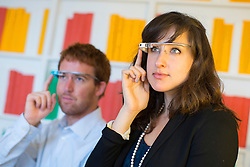 © licensed to London News Pictures. London, UK 06/11/2013. Google staff demonstrating how the Google Glass can help make the life easier with the company's most advanced Voice Search technology at the Google House in London. Photo credit: Tolga Akmen/LNP