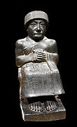 Statue of Gudea. Made from Diorite. Mesopotamian, from ancient Girsu. Circa 2150-2100 BC. Belongs to a series of diorite statue commissions by Gudea, who was governor of Lagash.