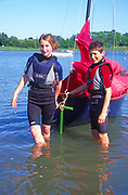 AT5BYA Girl and boy twins with their Mirror dinghy sailing boat