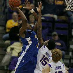 Jan 04, 2010; Baton Rouge, LA, USA; McNeese State Cowboys forward Patrick Richard shoots over LSU Tigers forward Dennis Harris (15) during the second half at the Pete Maravich Assembly Center. LSU defeated McNeese State 83-60.  Mandatory Credit: Derick E. Hingle-US PRESSWIRE
