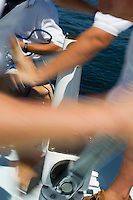 Sailors Cranking Sails During Yacht Race
