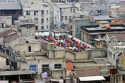SHAOXING, CHINA - <br /> <br /> Rooftops With A Wide Variety Of Uses Around China<br /> <br /> After the story from China Last week on A Chinese man has spent six years building his dream mountaintop villa - on top of a Beijing apartment block.  we show how you can get away with making the most of your roof top with these legal designs...<br /> <br /> Pupils do morning exercise at a rooftop playground at Lingzhi Primary School in Wuhan, Hubei Province of China. <br /> ©Exclusivepix
