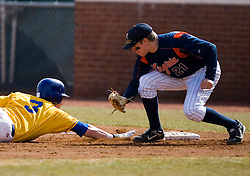 Virginia Cavaliers pitcher/firstbaseman Sean Doolittle (21) tries to tag out a Delaware base runner in a pickoff play.  The Virginia Cavaliers Baseball Team defeated the Delaware Blue Hens 3-2 to complete the sweep of a three game series at Davenport Field in Charlottesville, VA on March 4, 2007.