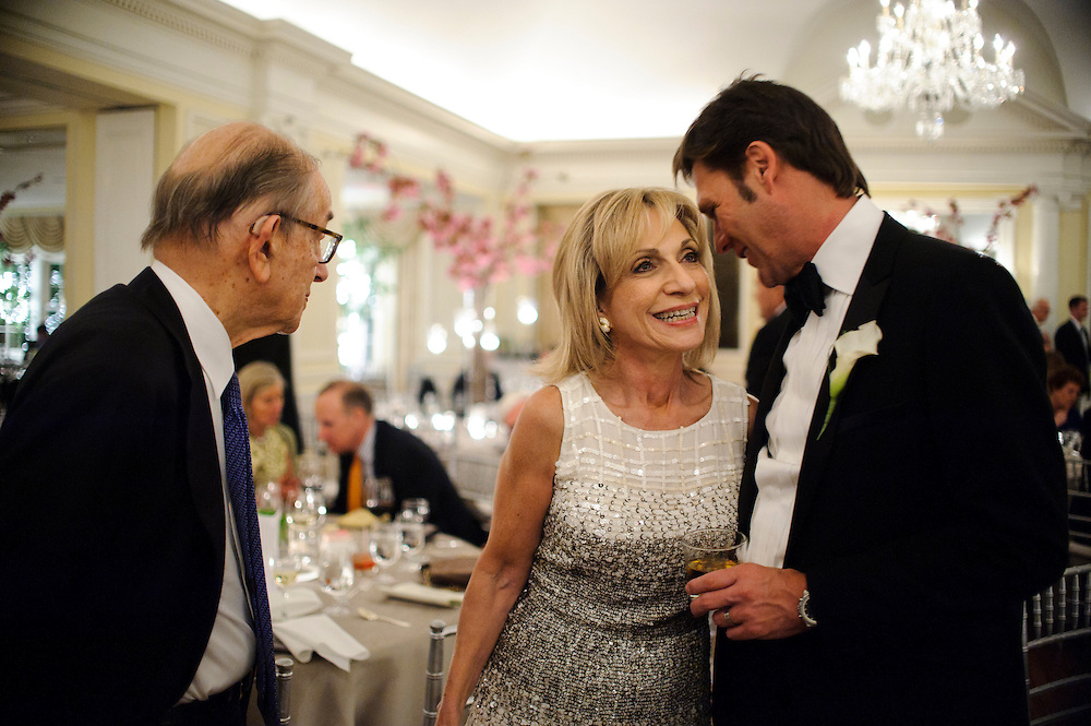 photo by Matt Roth.Saturday, April 14, 2012.Assignment ID: 30124225A..Celebrities in attendance! Former Federal Reserve Chair Alan Greenspan and his wife NBC News Chief Foreign Affairs Correspondent Andrea Mitchell talk with groom Lee Cowan during his and Molly Spencer Palmer's wedding reception at the Chevy Chase Club in Washington D.C. Saturday, April 14, 2012...Molly Palmer, 29, and Lee Cowan, 46, were colleagues at NBC News, but it wasn't until The Balloon Boy story coverage in 2009 that their romance sparked.