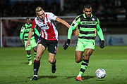 Forest Green Rovers Dan Wishart(17) runs forward under pressure from Cheltenham Town's Danny Wright(9) during the EFL Trophy match between Cheltenham Town and Forest Green Rovers at Whaddon Road, Cheltenham, England on 3 October 2017. Photo by Shane Healey.