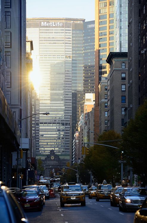 Reflection of sun on Park Ave. Manhattan, NY, USA.