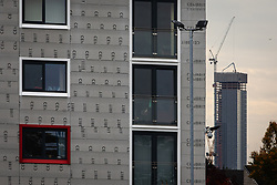 "© Licensed to London News Pictures . 11/10/2018. Salford , UK . GV of Hornbeam Court on The Square with temporary cladding fitted on lower floors and new Manchester Development known as ""The Twin Towers"" in the background . Recently installed cladding at several council-owned tower blocks in Salford has been identified as having similar dangerous properties to that which was installed on the Grenfell Tower in London . Residents have been waiting months for clarification on what action will be taken to make their homes safe . Photo credit : Joel Goodman/LNP"