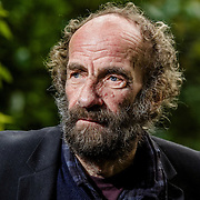 UK. Bath.<br /> formerly homeless over Christmas and now running a business as a gardener, Malcolm Ricks. Photographed in both the gardens where he would sometimes sleep and the steps next to the homeless shelter where he would spend his days.