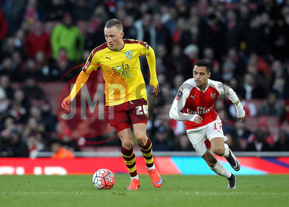 Fredrik Ulvestad of Burnley is put under pressure from Alexis Sanchez of Arsenal - Mandatory byline: Robbie Stephenson/JMP - 30/01/2016 - FOOTBALL - Emirates Stadium - London, England - Arsenal v Burnley - FA Cup Forth Round