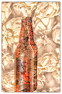 A creatively rendered multiple exposure photo of a beer bottle and hops.