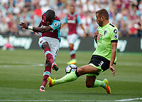 Football - 2016 / 2017 Premier League - West Ham United vs. AFC Bournemouth<br /> <br /> Bournemouth's Steve Cook throws himself in the way of another West chance at The London Stadium.<br /> <br /> COLORSPORT/DANIEL BEARHAM
