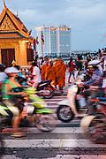Monks crossing Preah Sisowath Quay, Phnom PenhPhnom Penh