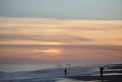two fisherman at sunrise in East Hampton, NY