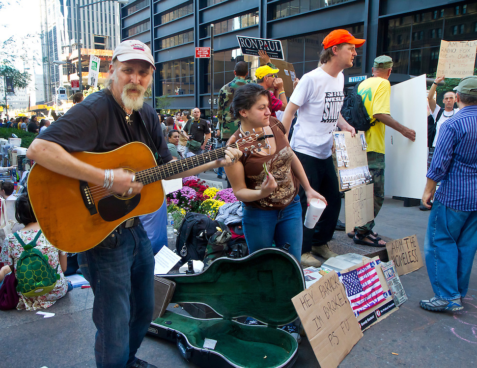 Eleventh of 30. The 99% percenters demonstrating their anger with Wall Street's greed by occupying Zuccotti Park. Just off lower Broadway almost at the foot step of the new World Trade Center.