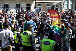 "© Licensed to London News Pictures . 06/05/2018. London, UK. Police separate anti fascists on Whitehall . Supporters of alt-right and anti-Islam groups, including Generation Identity and the Democratic Football Lads Alliance, demonstrate at Whitehall in Westminster, opposed by anti-fascists. Speakers billed in the ""Day for Freedom"" include former EDL leader Tommy Robinson, Milo Yiannopoulos, youtuber Count Dankula (Markus Meechan), For Britain leader Anne Marie Waters, UKIP leader Gerard Batten, Breitbart's Raheem Kassam and Lauren Southern. The event was originally planned as a march to Twitter's HQ in protest at their banning of Robinson and the Home Office's ban on Martin Sellner and Brittany Pettibone entering the UK, in what protesters describe as limits being imposed on free speech. Photo credit: Joel Goodman/LNP"