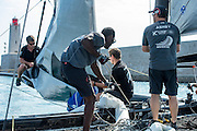 Sulaiman Almanji of Team Oman Air replaces Emirates Team New Zealand sailor Edwin DeLatt when Edwin took ill. Helping Richard Meacham, Dylan Ewing and Glenn Ashby to raise the jib before racing on day three of the Extreme Sailing Series Regatta at Nice. 4/10/2014