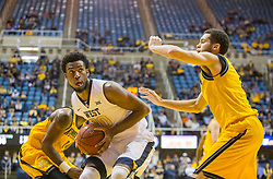 Dec 5, 2015; Morgantown, WV, USA; West Virginia Mountaineers forward Brandon Watkins (20) shoots a jumper along the baseline during the second half against the Kennesaw State Owls at WVU Coliseum. Mandatory Credit: Ben Queen-USA TODAY Sports