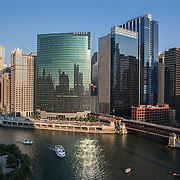 Chicago skyline along the Chicago River.<br /> Photography by Jose More