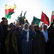 August 12, 2012 - Kafa Safra, Efrin, Syria: Syrian Kurdish women arrive at the funeral and ceremony of martyrdom of Taliz Gadalum, a Kurdistan Workers' Party (PKK) fighter killed days earlier during combat against the Turkish army...PKK has been fighting an armed struggle against the Turkish state for an autonomous Kurdistan and greater cultural and political rights for the Kurds in Turkey, Iraq, Syria and Iran. Founded on 27 November 1978 in the village of Fis, was led by Abdullah Öcalan. The PKK's ideology was originally a fusion of revolutionary socialism and Kurdish nationalism - although since his imprisonment, Öcalan has abandoned orthodox Marxism. The PKK is listed as a terrorist organization by Turkey, the United States, the European Union and NATO. (Paulo Nunes dos Santos)